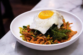 Crispy Pig's Ears with Kale, Pickled Cherry Peppers, Fried Egg at The Purple Pig in Chicago