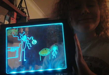 Glow Art light up drawing board with child's drawing example