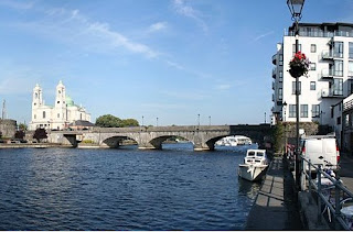wide river in Athlone, County Galway - with bridge over it and castle to one side