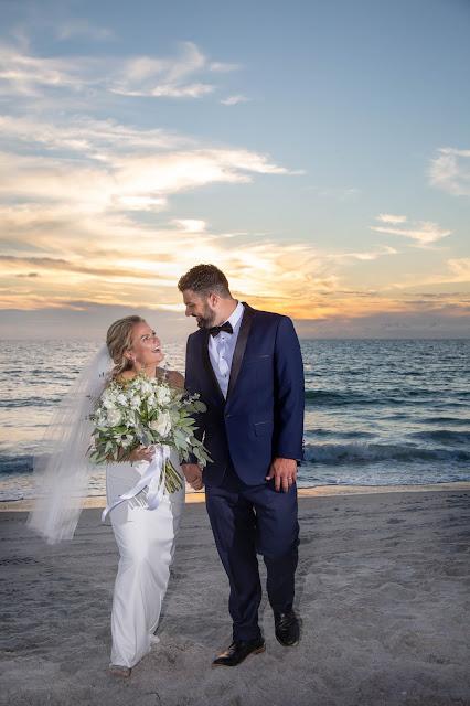 Sunset photographs of beach wedding with bouquet.