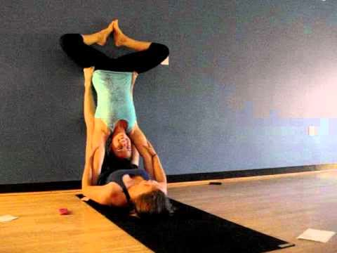 upside down bat partner yoga pose  partner yoga poses for