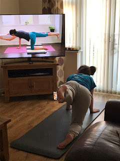 Girl doing yoga with Adrienne