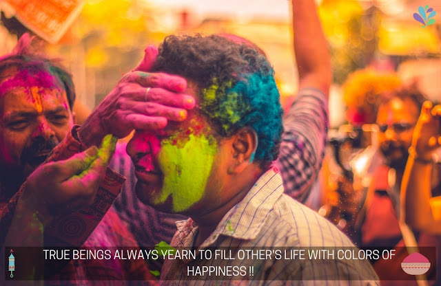 HAPPY HOLI 2021 QUOTES : PEOPLE PLAYING HOLI WITH HOLI COLOURS / COLORS