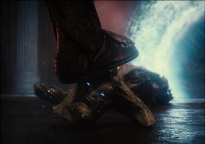 Darkseid's foot stepping on Steppenwolf's severed head, eyes still glowing.