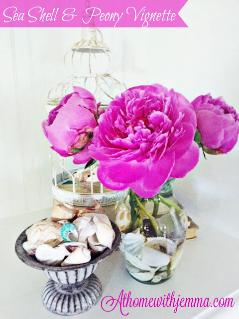 peonies, birdcage, clear vase, vintage tin bowl, glass dish, decorating