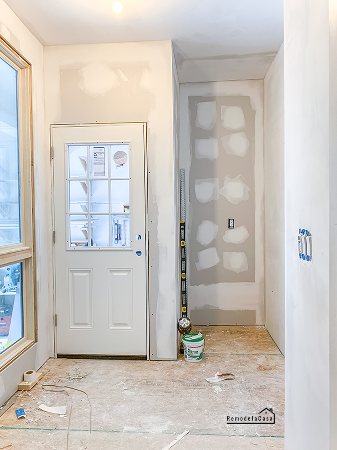 subfloor and patched walls in mudroom