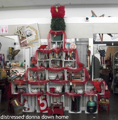 Creating a crate tree, Christmas tree, Christmas display antique mall booth, Riverfront Antique Mall
