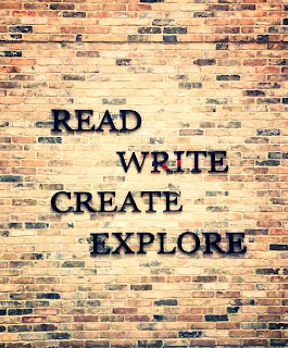 Tan, brick wall with the words: READ WRITE CREATE EXPLORE