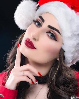 صورة بنت كيوت لبسة ملابس بابا نويل
