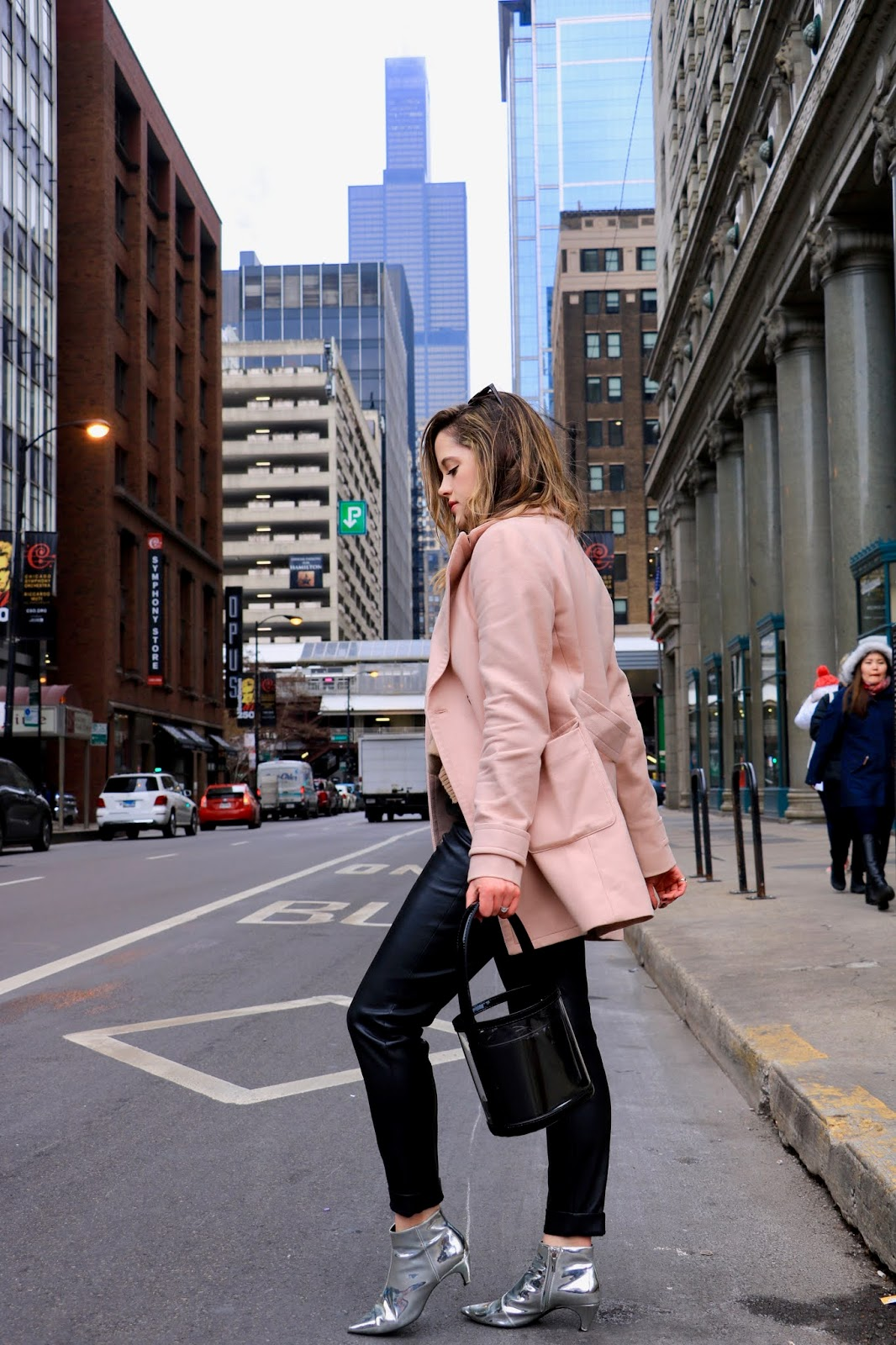 Chicago fashion blogger Kathleen Harper wearing a leather pants outfit.