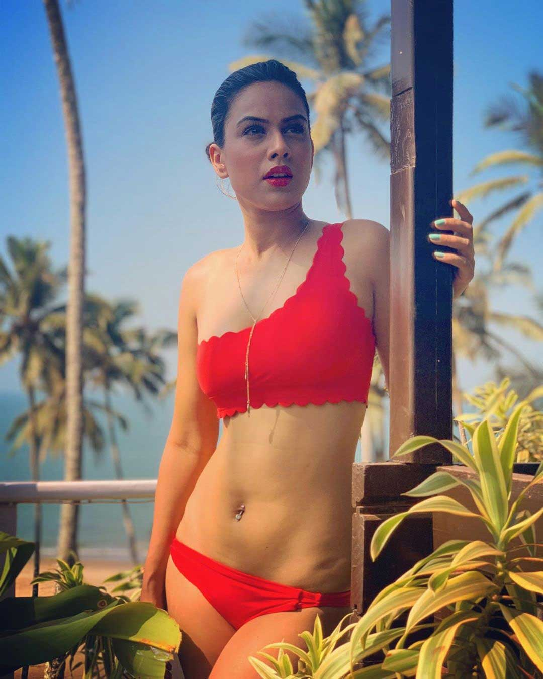 Nia Sharma Hot and Sexy in red Bikini