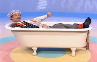 Mr Noodle puts a bonnet on his head and gets into the bathtub without taking off his clothes. Sesame Street Elmo's World Bath Time The Noodle Family