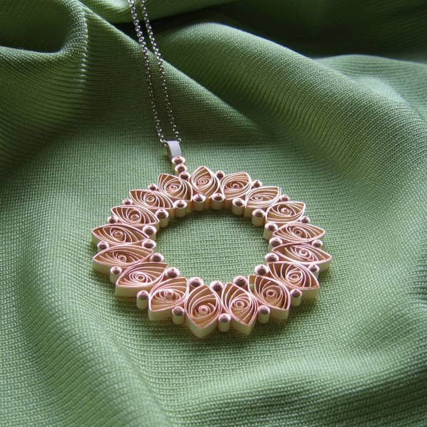 circular quilled pendant made with rose gold metallic edge quilling paper