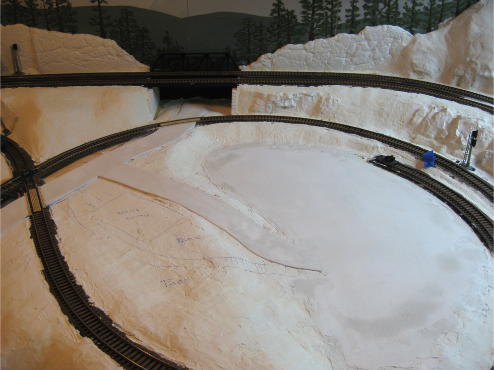 Road and leveled circular cul-de-sac area made from Smooth-It for future model railroad downtown scene