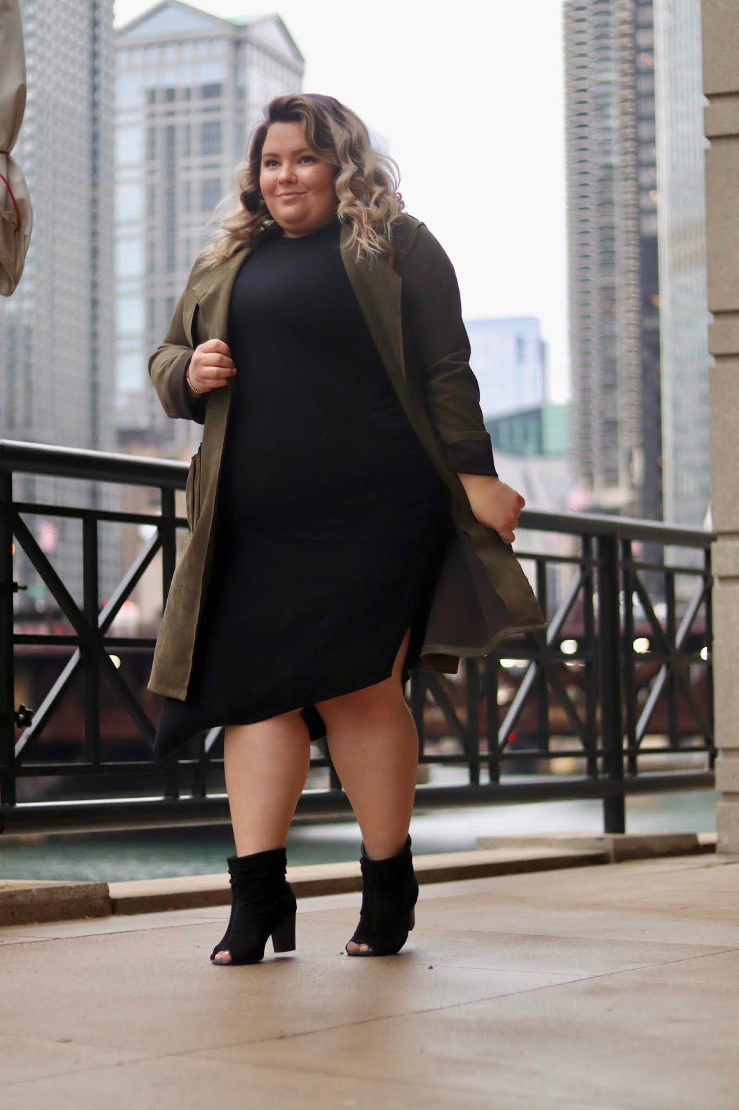 Chicago Plus Size Petite Fashion Blogger, influencer, YouTuber, and model Natalie Craig, of Natalie in the City, reviews Cobalt District's Midi Bodycon Dress made of Tencel and Merino Wool with a shape wear power mesh lining.
