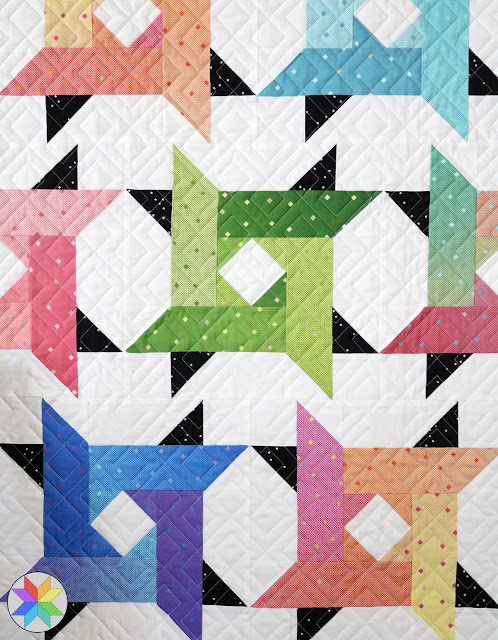 Windy City quilt pattern by Andy of A Bright Corner - perfect for using jelly roll strips or scraps