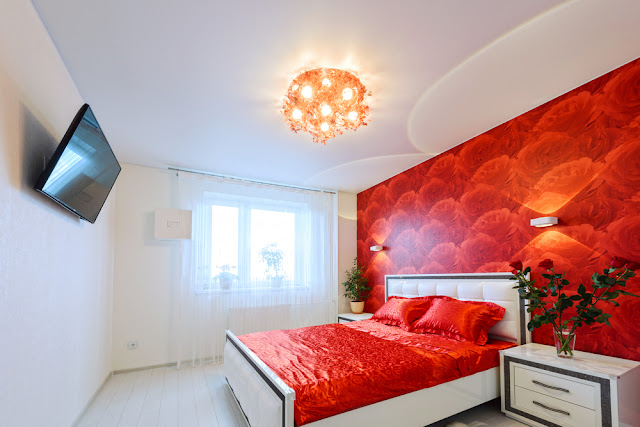 A White Bedroom with a Lustful Red Touch