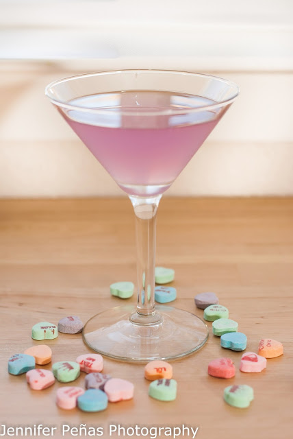 Cupid's Cup cocktail combines Hpnotiq Harmonie, vodka, cointreau and lime juice for a fun pink cocktail.