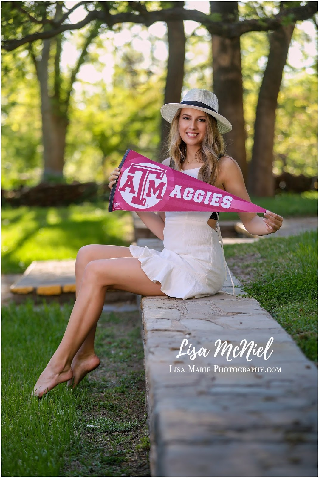 pretty teen girl in white dress and hat holding Texas A&M penent