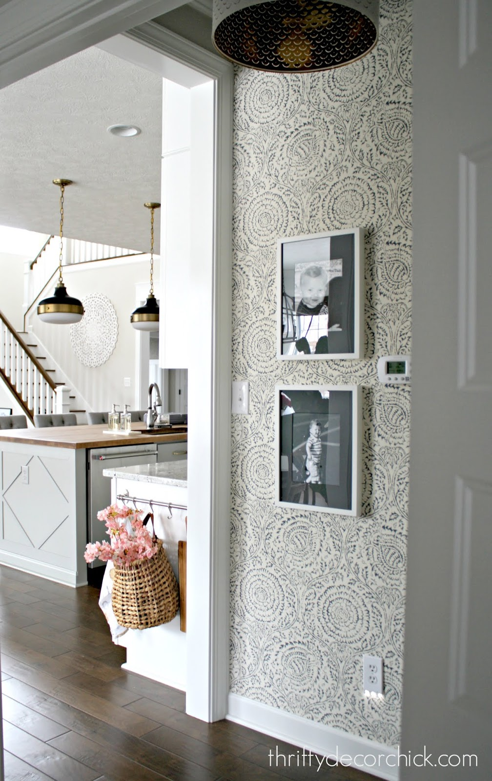 Small hallway makeover with white and blue floral wallpaper