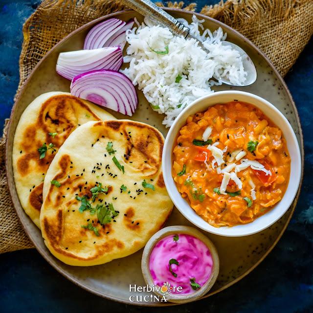 Indian Thali-naan, paneer akbari, rice, salad and raita