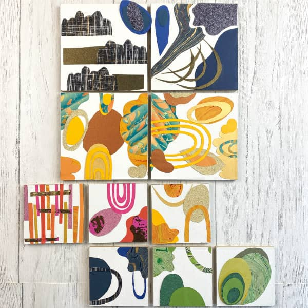 colorful paper collage squares in two sizes hanging on wall