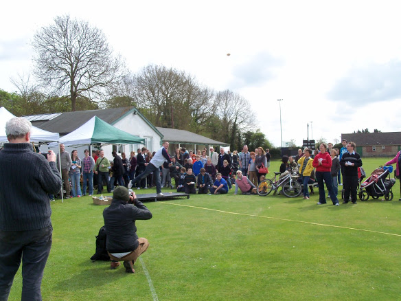 Throwing a currant bun at the World Bun Throwing Championships at Abingdon Vale Cricket Club
