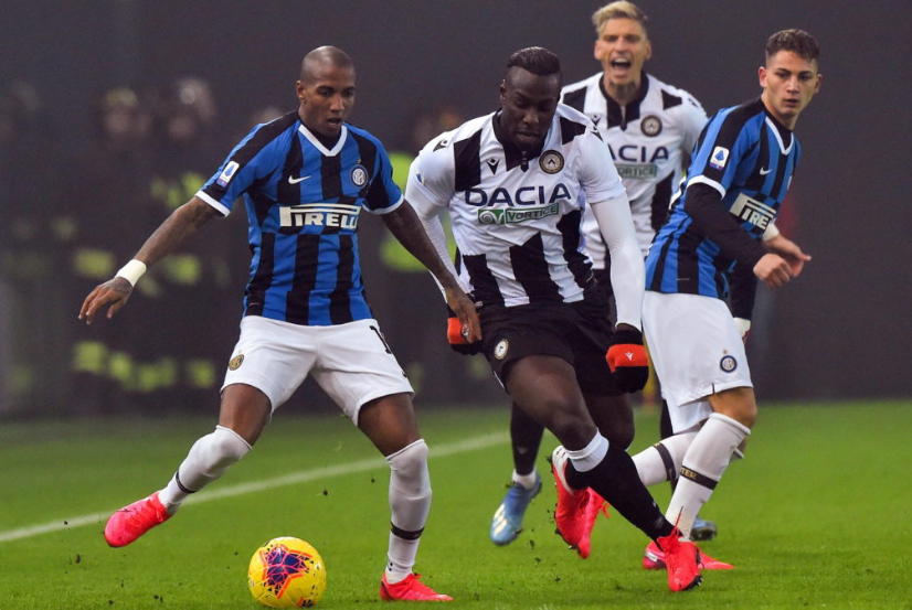 Young battles for possession against Udinese's Stefano Okaka