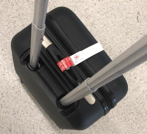 mala de bordo com adeviso da Air Canada