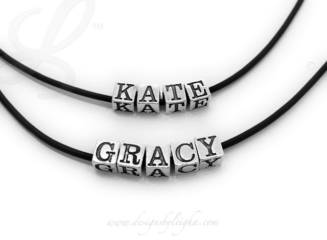 """Gracy has 5 sterling silver block letters (0 spacers) on a 16"""" leather and sterling silver necklace. Kate has 4 block letters (0 spacers) on a 16"""" leather necklace with a sterling silver lobster clasp."""