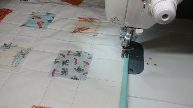 Machine sewing binding