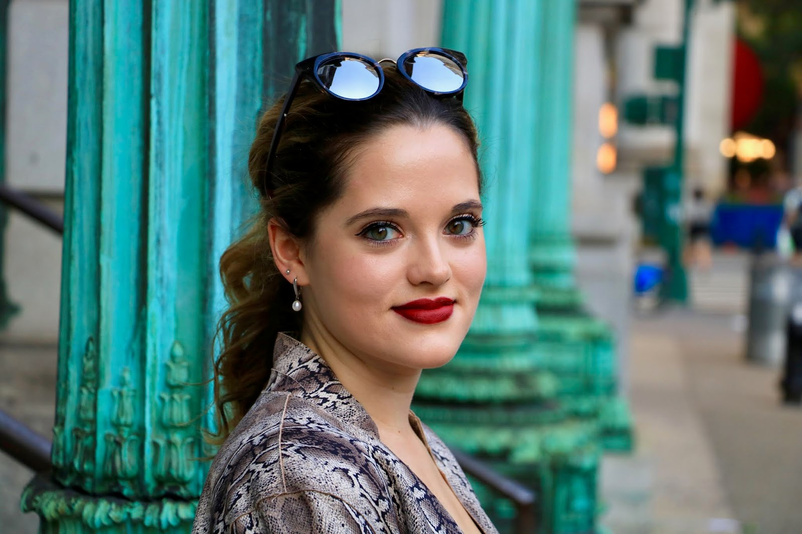 Nyc fashion blogger Kathleen Harper wearing pearl drop earrings and red lipstick.