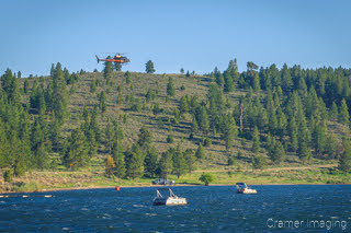 Cramer Imaging's photograph of a helicopter filling a bucket with water out of Panguitch Lake for wildfire fighting