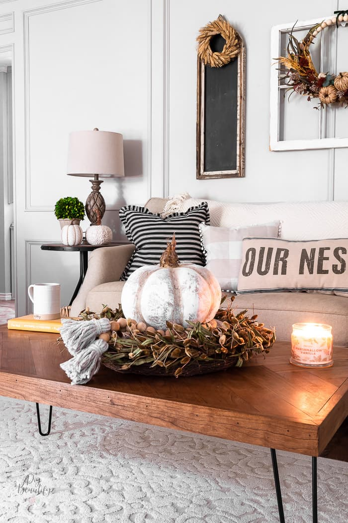 herringbone coffee table with pumpkin centerpiece