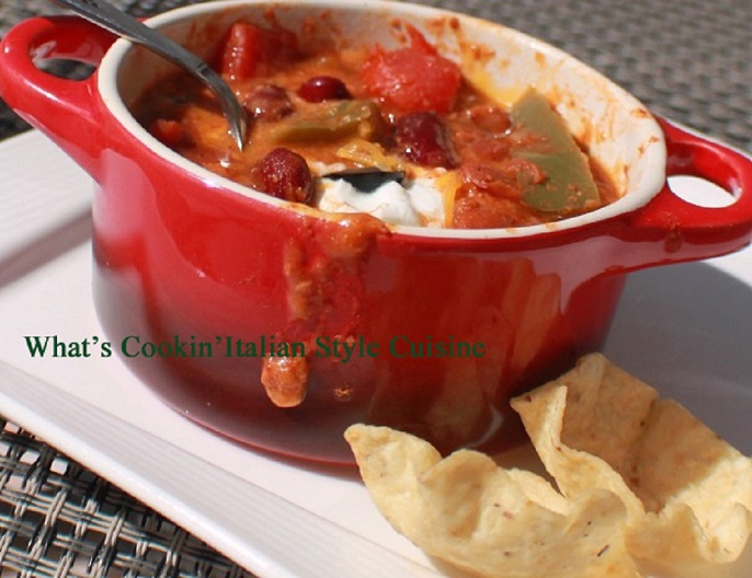 this is a crock of Guinness beer chili con carne in a red ceramic pot