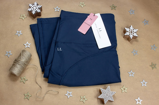 Navy sports leggings which retain their shape from Love Leggings folded ready to wrap