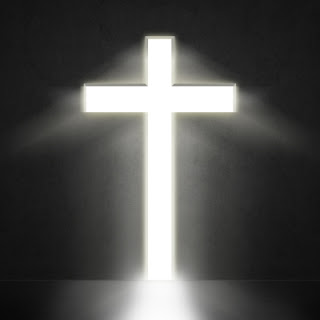 blazing white cross against a dark background