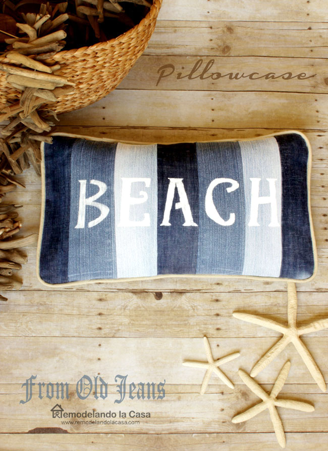 old jeans repurposed into a pillowcase with the words beach