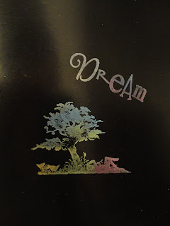 "Daydreamer under tree and ""dream"", mica on black card"