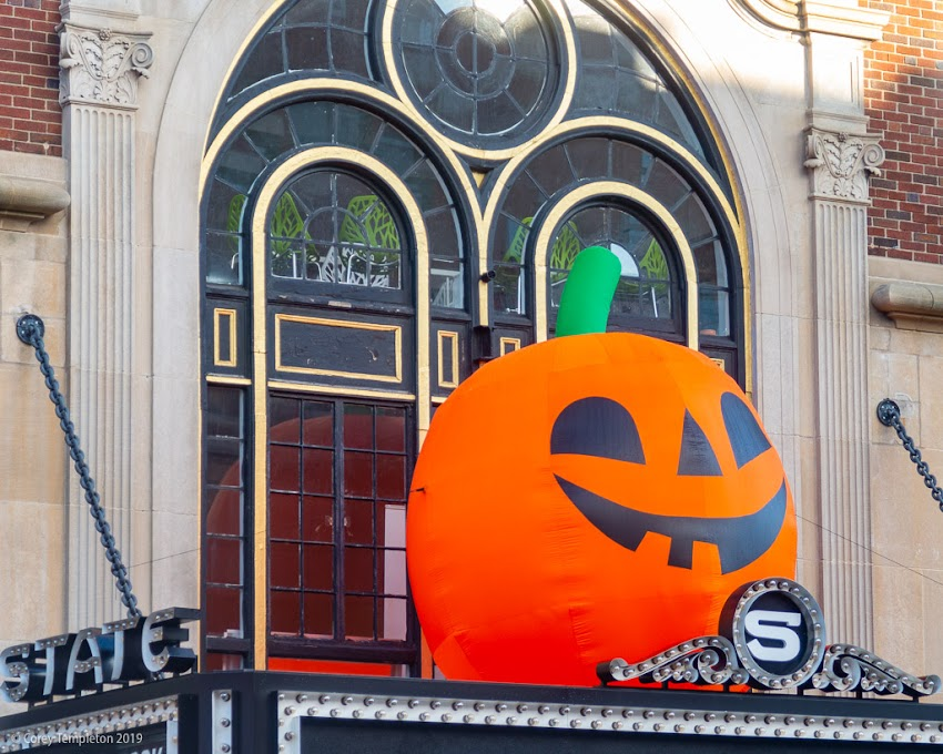 "Portland, Maine USA October 2019 photo by Corey Templeton. A large pumpkin atop the State Theater marquee, perhaps related to the recent ""Great Pumpkin Ball"" by EqualityMaine."