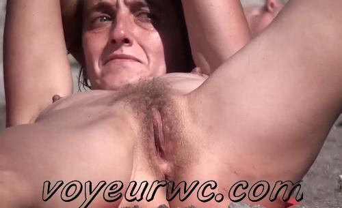 Nude sun tanning women a beach spy cam (BeachVoyeur 37-41)