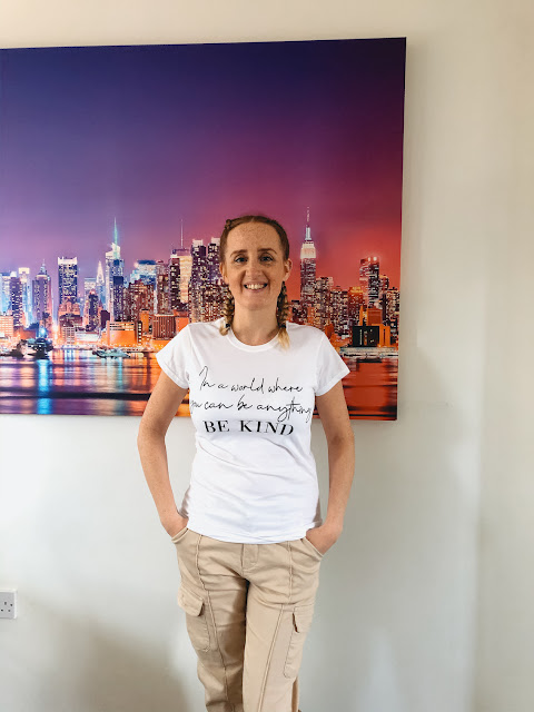Comfy casual with Femme Luxe / standing in front of a large canvas with white Be Kind t-shirt
