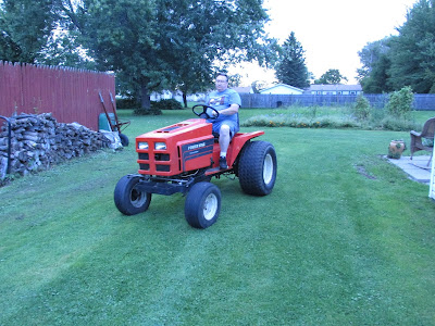 Husband on tractor he rebuilt