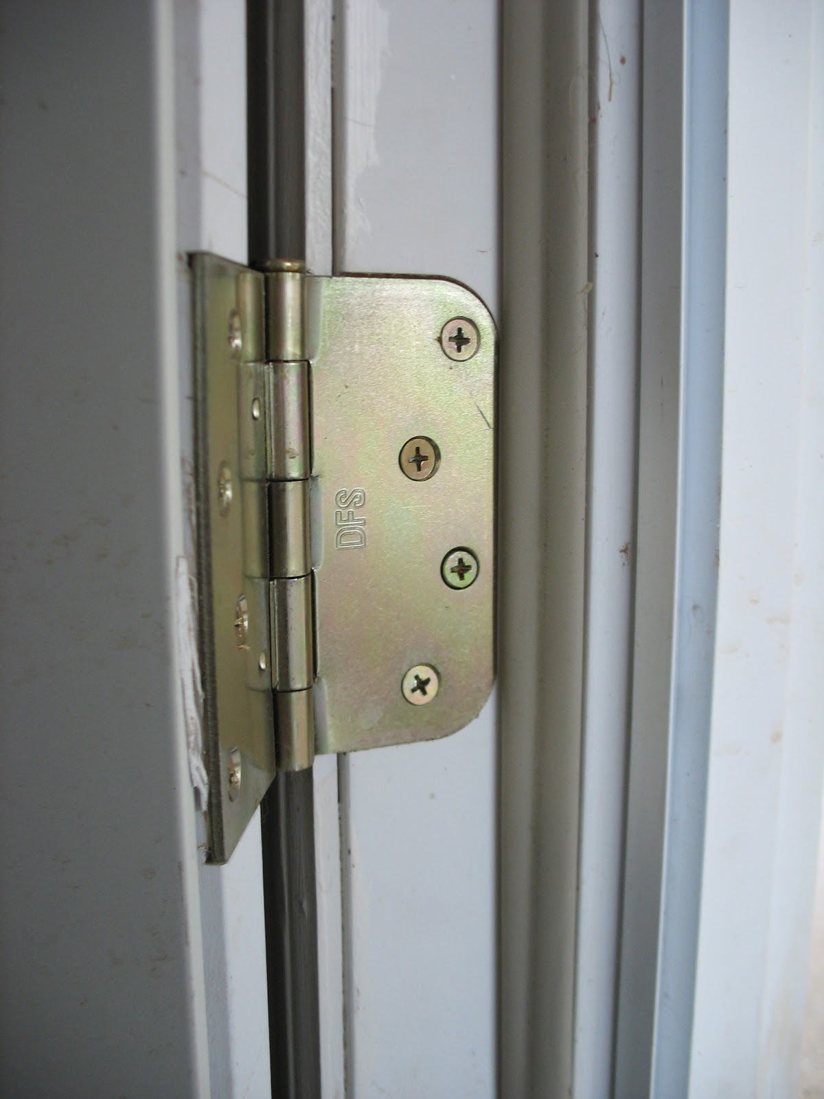 Slot in door hinges