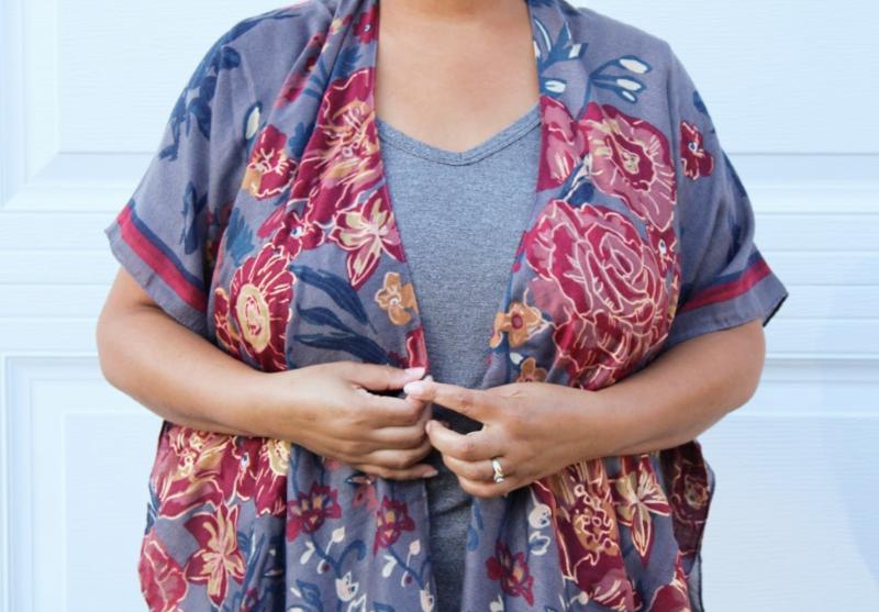 a woman wearing a grey floral kimono