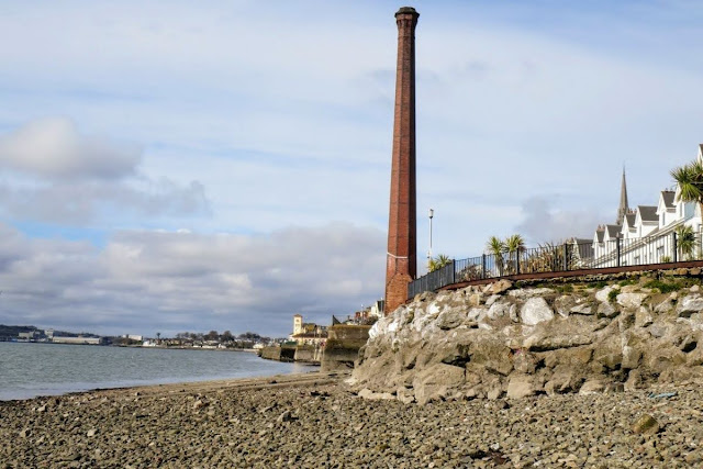 Cork to Cobh by Train: Historic chimney on the beach