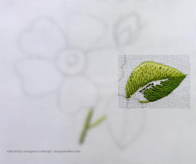 Stitching the first row of the second half of the needlepainted leaf