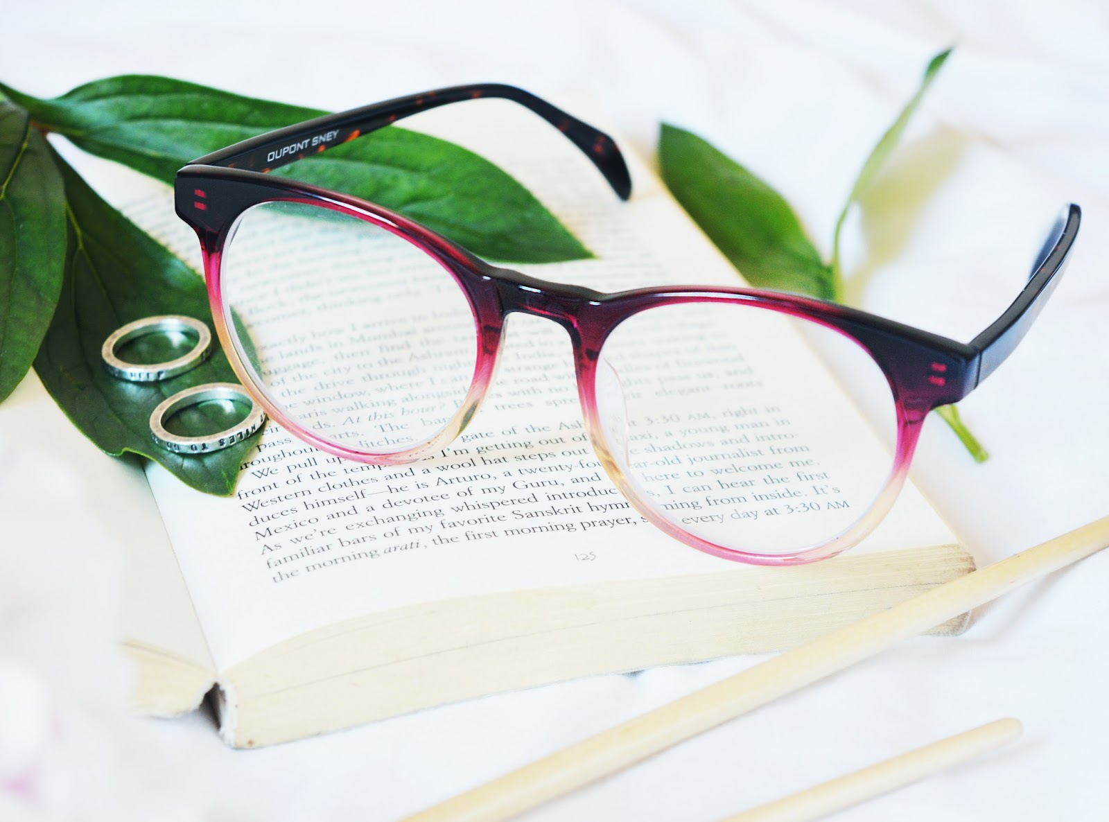 pink glasses on book