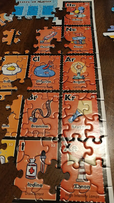 putting together Periodic Table of the Elements puzzle