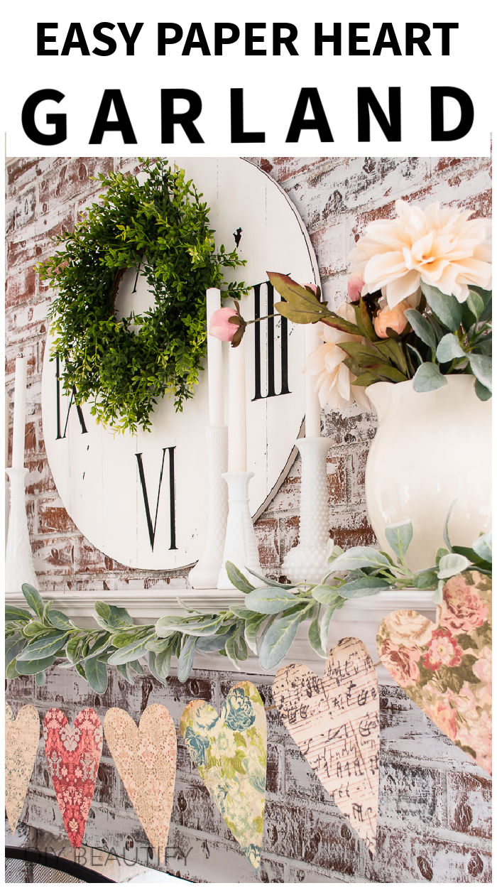 vintage heart garland hanging from painted fireplace mantel with lambs ear greenery and blush florals